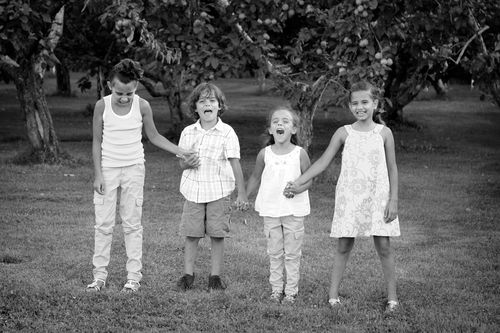 Kids in orchard bw