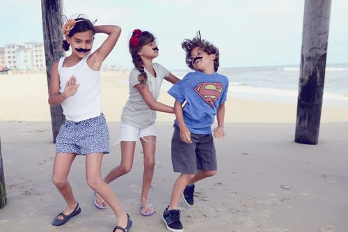 Moustached kids dancing
